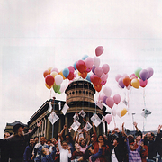 Balloons being released outside the building during the 25th Anniversary celebrations
