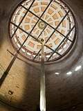 giant-sword-hanging-from-domed-ceiling-seen-from-below
