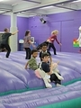 young boys at play on the inflatable